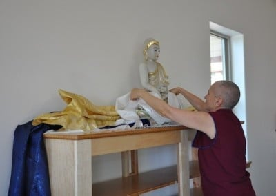 Venerable Chodron offers a khata and Mark and Larry  from the construction crew follow suit.