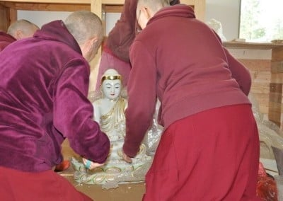 The jade Buddha offered by Joline and Richard arrives  and is gently unpacked and removed  from its crate.