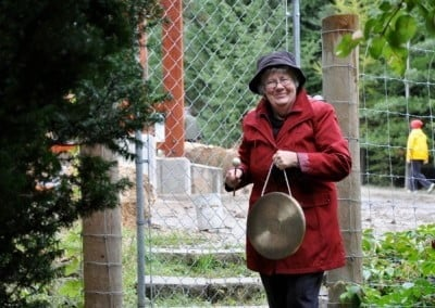 Doris rings the gong for the group to assemble in the meditation hall.