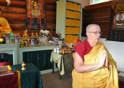 Venerable Jigme chants the Chenrezig mantra in front of the abundant <br> offerings at our Lama Chopa puja.