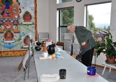 Mark kindly vacuums, creating a clean environment for Chenrezigs-to-be.