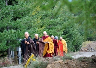 Venerable Jendy leads the procession of bhikshuni elders and Ruby to the hall.