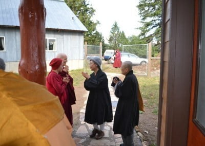 Venerable Jendy gives parting wise words to Venerables Jampa and Semkye before she departs.