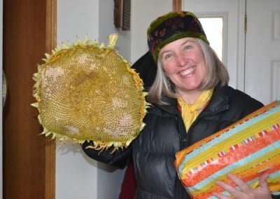Julia brings a large sunflower from her garden to brighten the day.