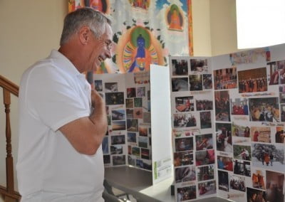 Mont enjoys looking at the photos that have been assembled on poster board, detailing the history of the abbey
