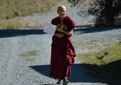 Venerable Thubten Semkye brings the Chenrezig statue to be placed in the hall for inspiration.