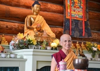 Venerable Thubten Chodron receives a smile from the Buddha while she teaches.