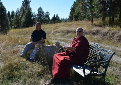 Venerable Thubten Yeshe and Howard enjoy the sun.