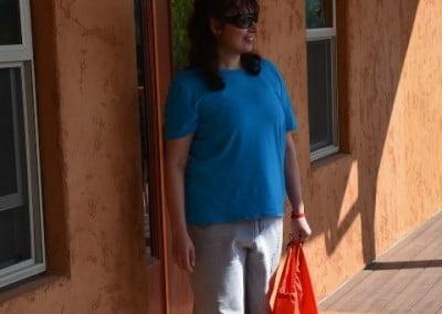 Helena prepares to depart Chenrezig Hall.