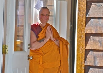 Venerable Thubten Tsultrim waits to greet our guests.