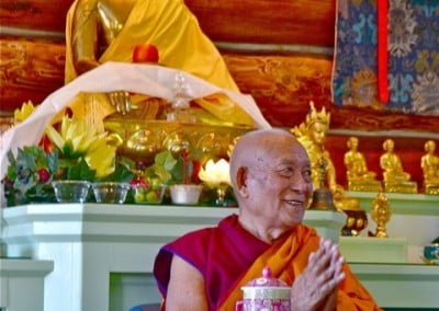 Geshe Thabkhe joins in the prayers.