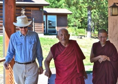 Venerable Thubten Damcho escorts our guests to Chenrezig Hall.