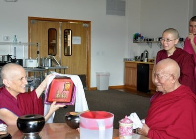Geshe Thabkhe gives a gift to the Abbey.