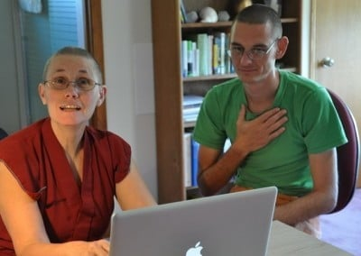 Venerable Thubten Chonyi and Nathan check the schedule.