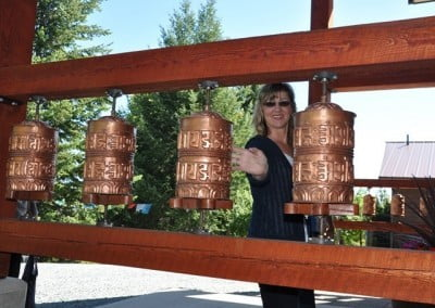 The prayer wheels in front of Chenrezig Hall are popular.