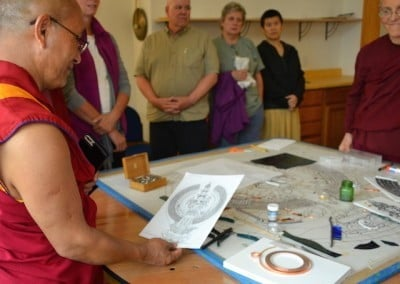 Geshe Dadul takes the time to learn about how our awesome new stained-glass window was created.