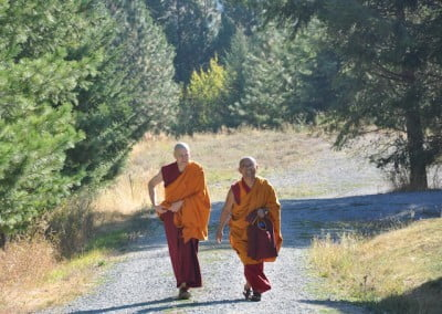 Ven. Losang escorts Geshe Dadul to the Meditation Hall.