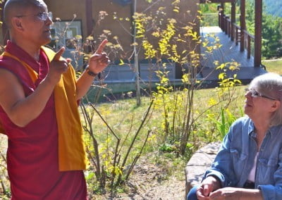 Geshe Dadul shares a thought with Sandra, who is visiting from his center in Atlanta.
