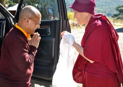 Ven. Chodron greets Geshe-la with a smile and a kata.