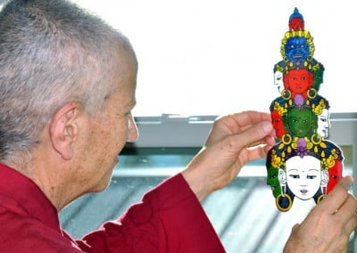 Ven. Chodron inspects a replica of Chenrezig's faces.