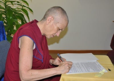 Ven. Chodron signing the offer we made to the new property.