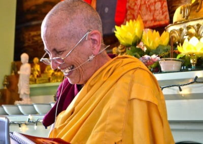 Close up photo of buddhist nun, Venerable Chodron laughing happily.