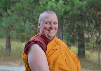 Close up photo of buddhist nun, Venerable Tsultrim smiling happily.