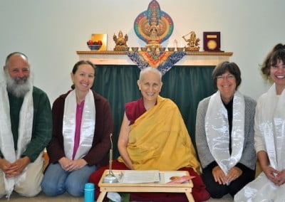 A Buddhist nun, Venerable Chodron posing with three women and one man.