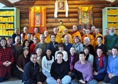 Group photo of buddhist sangha with laywomen and laymen in the Meditation Hall
