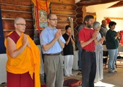 The retreatants chant Chenrezig's mantra while waiting for Venerable Chodron.