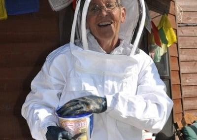 Buddhist nun, Semkye wearing a bee suit.