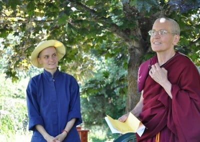 Dani looks on as Ven. Semkye tests the mic before giving the Bodhisattva Breakfast Corner talk.