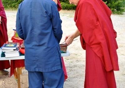 Ven. Samten distributes incense to purify the site.