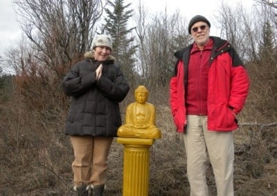Bill and Tracy pose with the Buddha