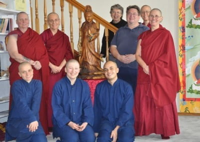 Tod Ransdell from Seattle, who offered this lovely Kuan Yin statue, poses with the community.