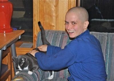 Dani gives Maitri a massage that our little cat friend enjoys.