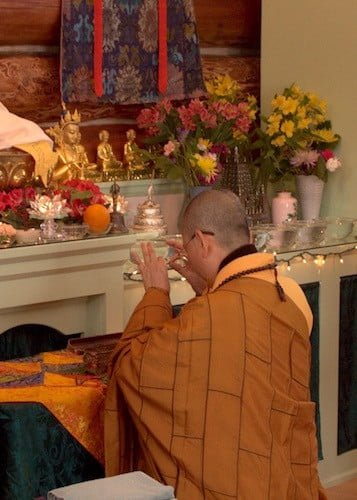 Ven. Minjia offers incense to the Buddha as the ordination ceremony begins.