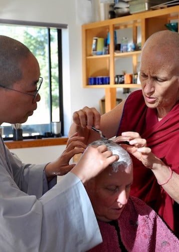 Ordination ceremony begins with the head-shaving ritual.