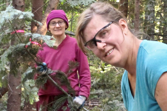 Ven. Samten and Janet love to volunteer in the forest.
