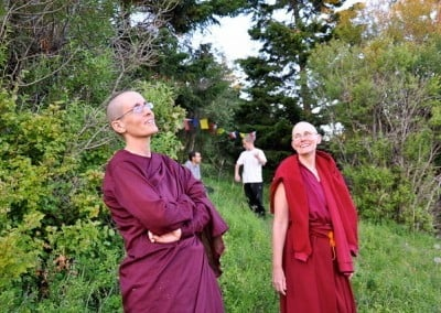 In the Abbey forest, a theravada nun look into the sky while buddhist nun, Chonyi is looking at her.