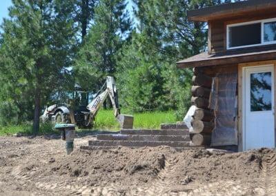 A bulldozer digging outside the Meditation Hall.