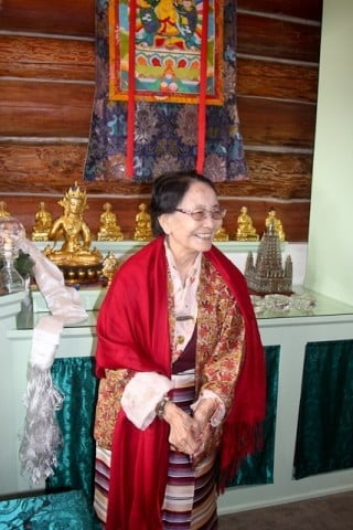 A smiling Dagmo Kusho-la in the Meditation Hall