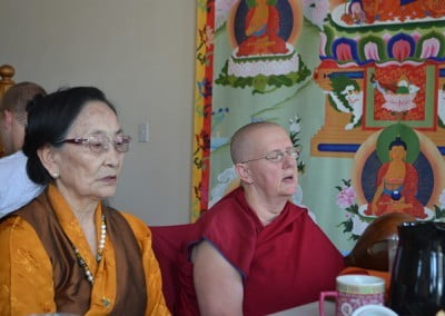 Dagmo-la sitting beside buddhist nun, Yeshe.