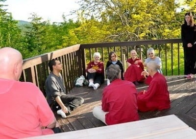 A small group of retreatants sitting down leisurely with Venerable Chodron.