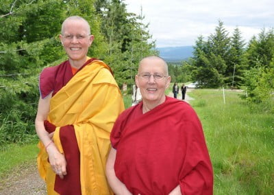 Buddhist nun, Venerable Tarpa and Venerable Jigme posing together with big smiles on their faces.