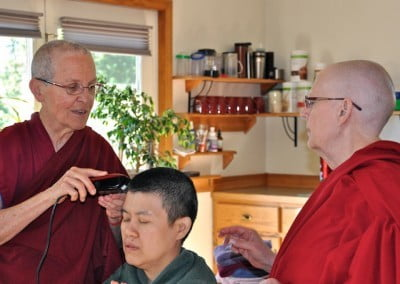 Vens. Semkye and Jigme begin the head shaving.