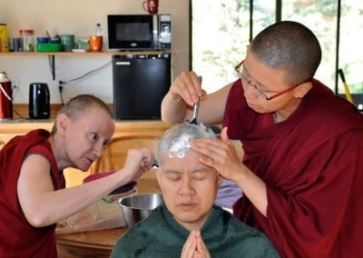 Bhikshunis Samten and Damcho continue the task of shaving Hsiao Yin's head.