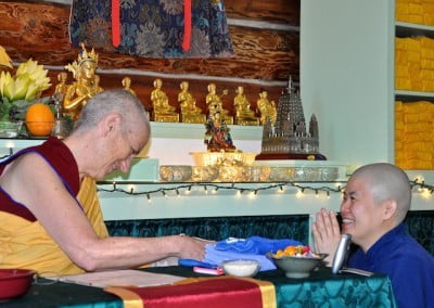 Hsiao Yin bows in front of Venerable Chodron in front of the altar in the Meditation Hall and makes an offering and a formal request.