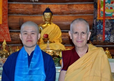 Hsiao Yin poses with Venerable Chodron in front of the Meditation Hall altar.