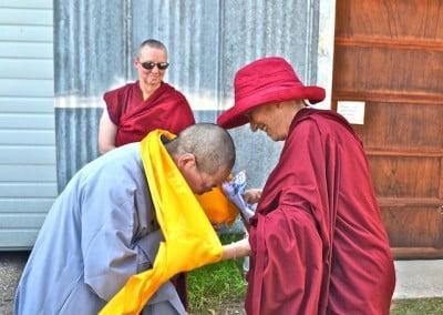 Venerable Chodron offers Venerable Jendy a khata